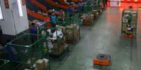 北京邮政上线智能搬运机器人 可载重半吨